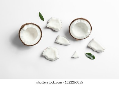 Composition with coconuts on white background, top view
