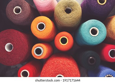 Composition of colorful vibrant wool threads from above. Autumn colours