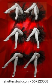 Composition completed by legs of female cabaret dancers dressed in black pantyhose