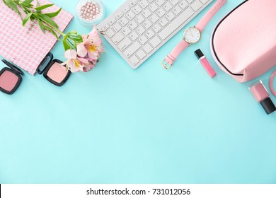 Composition with computer keyboard, cosmetics and flowers on color background. Beauty blogger concept
