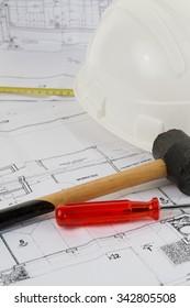 composition of construction tools hammer helmet level blueprints