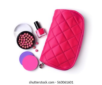Composition of cosmetics with nail polish, ball blush in open box, sponges and pink cosmetic bag isolated on white