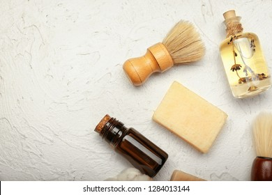 Composition with cosmetics shaving brushes for men on white background