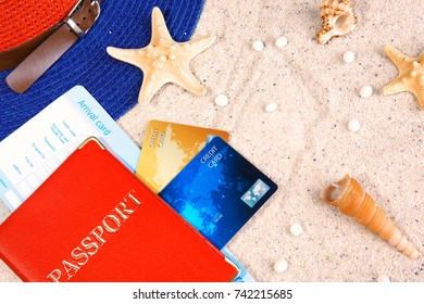 Composition with credit cards and passport on sand