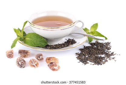 Composition with a cup of tea and various ingredients, isolated on white