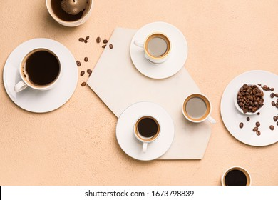 Composition with cups of different coffee on color background