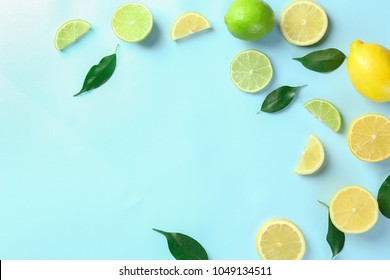 Composition with cut citrus fruits on color background, top view