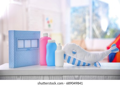 Composition with cute toy on table in baby room