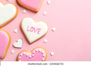 Composition with decorated heart shaped cookies and space for text on color background, top view. Valentine's day treat