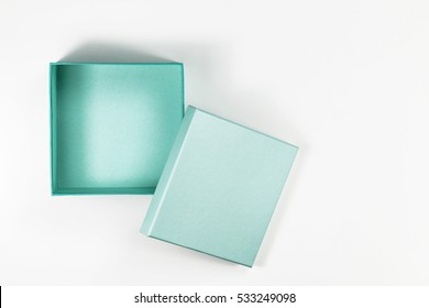 The Composition of Decorative Open, Small Flat, Green Box on White Background. Top View.