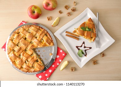 Composition with delicious apple pie on table, top view