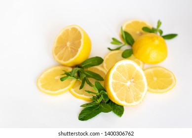 Composition of delicious citrus fruit and green leaves on white background.