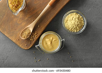 Composition with delicious mustard sauce in jar on table