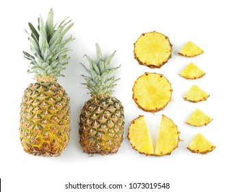 Composition with delicious pineapples on white background