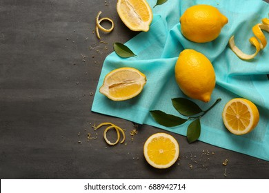 Composition of delicious sliced citrus fruit on dark background