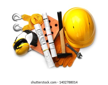 Composition with different construction tools on white background, top view