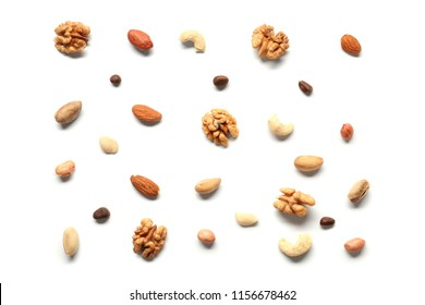 Composition with different nuts on white background