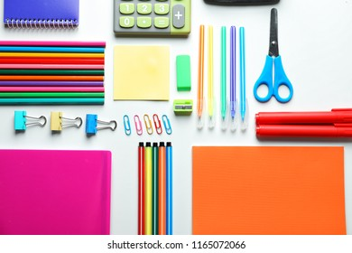 Composition with different school stationery on white background