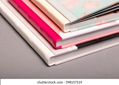 A composition of different sizes of photo books. A fragment of a binding of photobooks