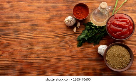 Composition with different spices on wooden table
