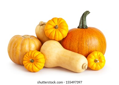 Composition of a different varieties of pumpkins on a white background.