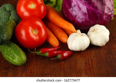 Composition of different vegetables on wooden background