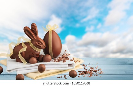 Composition with Easter eggs  in nest and flowers , on wooden background