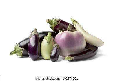 Composition of eggplants on white background