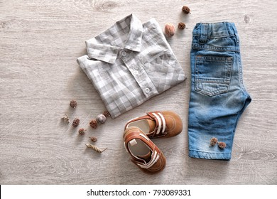 Composition with fashionable children clothes on wooden background