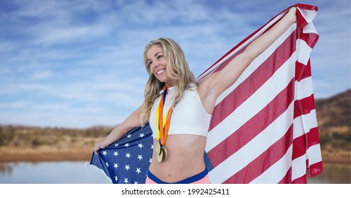 Composition of female athlete holding american flag against countryside. united states of america patriotism and independence concept digitally generated image.