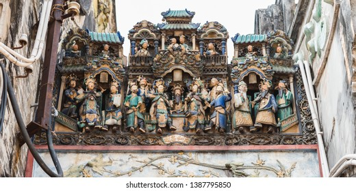 "Composition of figurines showing a crowded city scene on the roof of Thien Hau Temple (erected in c. 1760), one of the top tourist attractions of Cho Lon (""Chinatown""), Ho Chi Minh City, Vietnam."