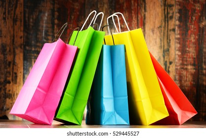 Composition with five colorful paper shopping bags.