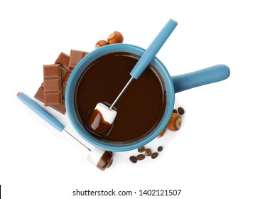 Composition with fondue pot, dark chocolate and marshmallow on white background, top view