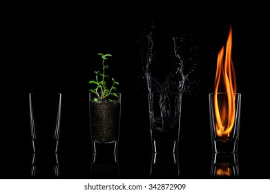 Composition of four elements in glass on black background