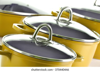 Composition with four steel kitchen pots