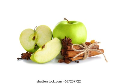 Composition with fresh apples and cinnamon on white background