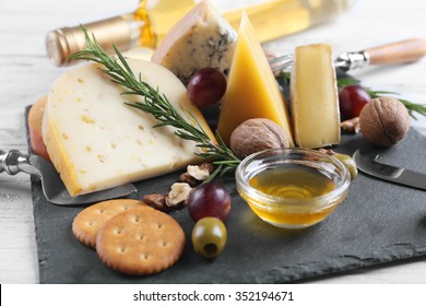 Composition of fresh cheese, wine, fruits and vegetables on the table, close up