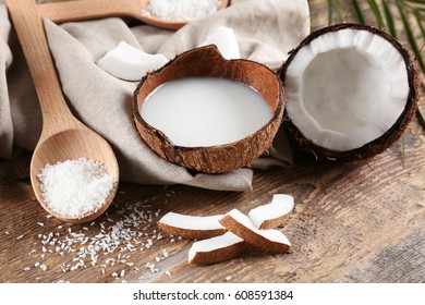 Composition with fresh coconut milk on wooden background