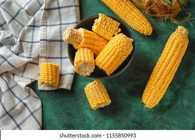 Composition with fresh corn cobs on table
