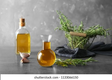 Composition with fresh rosemary oil on table