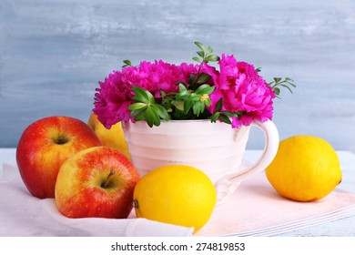 Composition with fresh spring flowers on wooden background