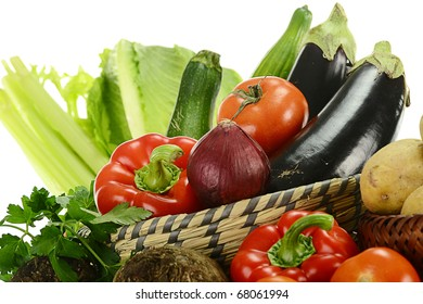 Composition with fresh vegetable and bowl isolated on white