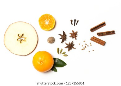 Composition of fruits and spices for mulled wine. Slice apples, mandarin, nutmeg, anise, coriander, cloves, cinnamon and cardamom.