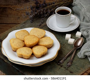 The composition of the gluten-free rice-banana muffin, a cup of coffee and a bouquet of lavender. Romantic breakfast. Vintage photo.