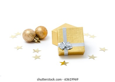 Composition of golden Christmas ornaments (giftbox and spheres)