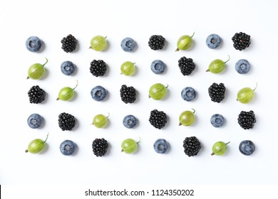 Composition with gooseberries, blackberries and blueberries on white background