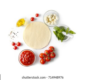 Composition with green fresh organic basil and ingredients for pizza isolated on white - Shutterstock ID 714948976