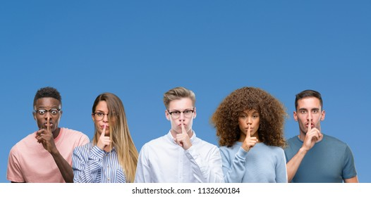 Composition of group of friends over blue blackground asking to be quiet with finger on lips. Silence and secret concept.