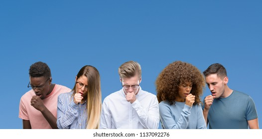 Composition of group of friends over blue blackground feeling unwell and coughing as symptom for cold or bronchitis. Healthcare concept.