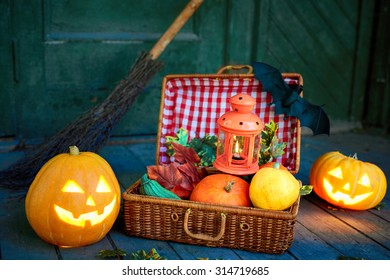 Composition of Halloween symbols by haunted house